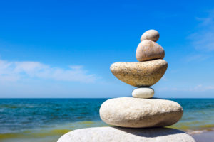 Rock Zen on the background of summer sea. Concept of harmony and balance